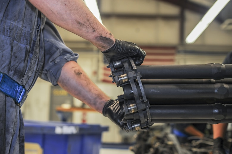 U.S. Air Force Airman 1st Class Joel Balmforth, 355th Aircraft Maintenance Squadron armament member, removes the mid-barrel support assembly from a GAU-8/A Gatling gun for cleaning and inspection at Davis-Monthan Air Force Base, Ariz., Oct. 24, 2016. The first in-flight testing of the weapon system took place on Feb. 26, 1974. (U.S. Air Force photo by Airman 1st Class Ashley N. Steffen)
