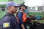 The Coast Guard, working with the Palau National Police, conducts fisheries enforcement boardings in the Palau exclusive economic zone under a bilateral agreement. (U.S. Coast Guard photo by Chief Petty Officer Sara Mooers)
