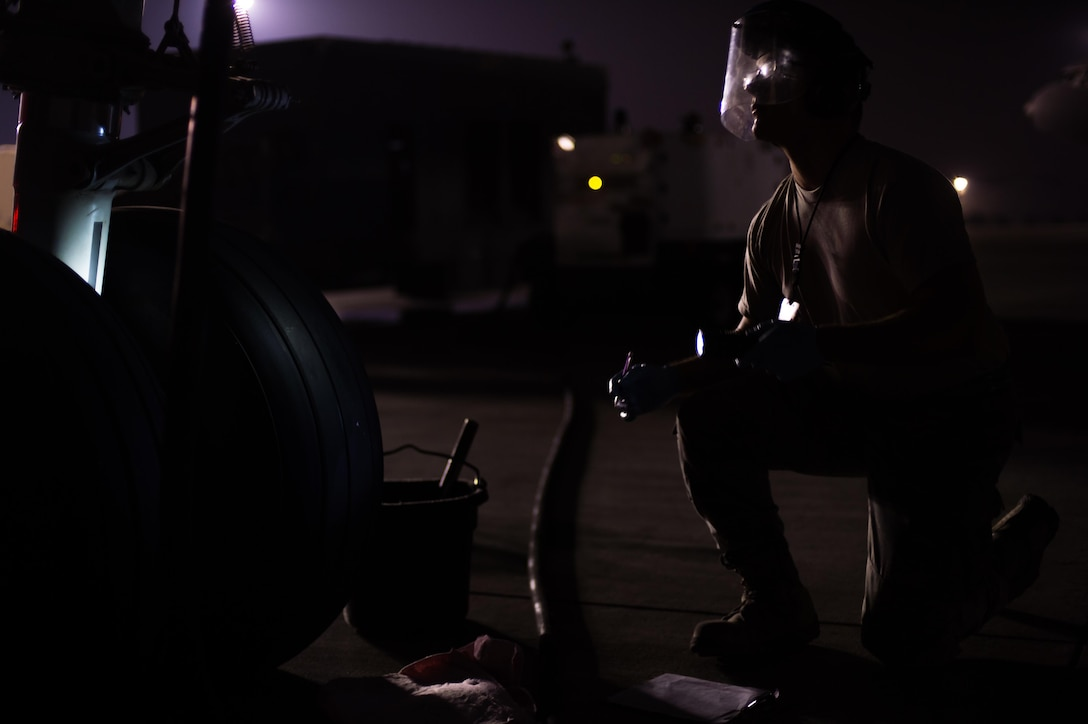 Airman 1st Class Richard, a KC-10 Extender fuel systems specialist, completes a fuels system inspection at an undisclosed location in Southwest Asia, Oct. 26, 2016. The KC-10s are providing refueling support to several coalition airframes working to liberate the city of Mosul, Iraq. (U.S. Air Force photo by Senior Airman Tyler Woodward)