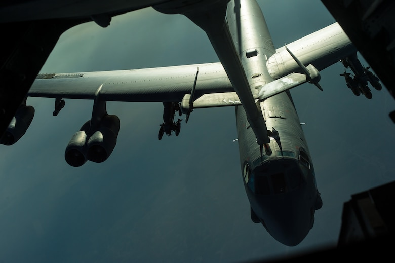 A U.S. Air Force B-52 Stratofortress receives fuel from a U.S. Air Force KC-10 Extender at an undisclosed location near Iraq, Oct. 26, 2016. The B-52 approximately carries 70,000 pounds of armament in the support of the liberation of Mosul, Iraq. (U.S. Air Force photo by Senior Airman Tyler Woodward)