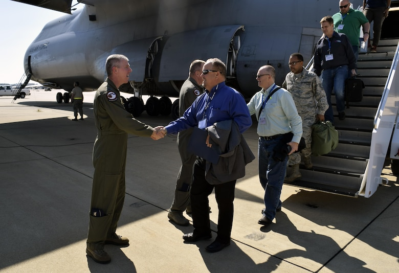 Col. James L. Morriss III, right, 307th Bomb Wing vice commander, welcomes Texas civic leaders and 433rd Airlift Wing members to Barksdale Air Force Base, La., Oct. 27, 2016 as they begin a two-day tour of the base. During their visit, community leaders toured the B-52 Stratofortress, flew in the aircraft's simulator, and saw demonstrations by the military working dogs, explosive ordnance and life support flights. (U.S. Air Force photo by Tech. Sgt. Lindsey Maurice)
