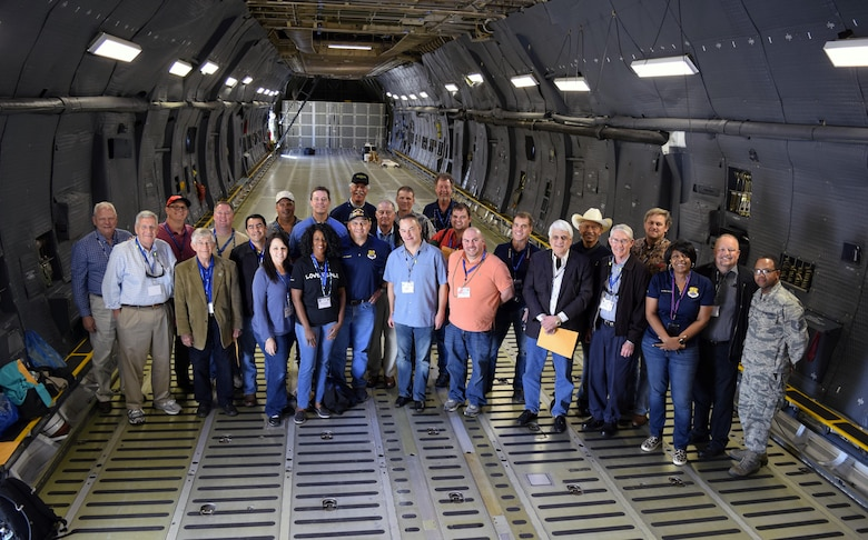 Civic leaders within San Antonio and its surrounding communities pose for a photo in the cargo bay of a C-5M Super Galaxy Oct. 28, 2016 on the Joint Base San Antonio-Lackland, Texas, flight line after returning home from a two-day tour of Barksdale Air Force Base, Louisiana. (U.S. Air Force photo by Tech. Sgt. Lindsey Maurice)