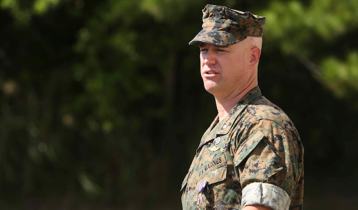 Lt. Col. Robert C. Sellers, 3rd Marine Expeditionary Brigade Assistant Chief of Staff G-4, addresses friends and family at his Purple Heart award ceremony in front of Secher Hall on Camp Hansen, Okinawa, Japan, October 28, 2016. The ceremony was held in front of Secher Hall to remind those in attendance to remember the fallen. Sellers is from Belvidere, Illinois.