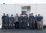 Personnel from DLA Troop Support Pacific, the Naval Submarine Support Command and the USS Columbus submarine are pictured in front of a new mobile galley at Joint Base Pearl Harbor-Hickam Oct. 25, 2016. The galley was purchase through DLA Troop Support's Subsistence supply chain and is used for temporary food service while submarines are undergoing maintenance.