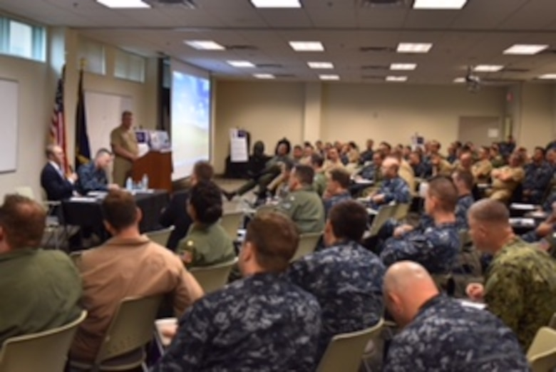 (Oct. 7, 2016) During a question and answer session, Dr. Andrew S. Erickson, PH.D Professor of Strategy, U.S. Naval War College, alongside Capt. Jeffrey T. Griffin, U.S. 7th Fleet Chief of Staff discusses the strategic direction of the U. S. Navy's presence to Sailors attending the 2016 Navy Reserve 7th Fleet Asia-Pacific Symposium at Naval Air Station Joint Reserve Base (NAS JRB) Fort Worth, Oct. 7-8. Navy Reserve Commander U.S. 7th Fleet hosted more than 100 Sailors from active, reserve and integrated commands during the 2016 Asia-Pacific Symposium at NAS JRB Fort Worth. The Asia-Pacific Symposium is designed to enhance the operational readiness of Reserve Sailors by providing training and exposure to the U.S. 7th Fleet area of responsibility.