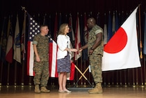 "Ambassador Caroline Kennedy, center, greets Sgt. Maj. Jeffrey A. Young, right, and Col. William DePue, left, Oct. 28 aboard Camp Foster, Okinawa, Japan. The community center was one stop along a tour of the military installations across Okinawa during which Kennedy addressed senior military leadership and their families living on Okinawa directly. ""I am always inspired by the patriotism I see here when I visit,"" said Kennedy. ""I want to thank everyone here for everything that you do for this outstanding partnership with Japan. There is a lot to learn here and all you leaders are doing a great job maintaining positive community involvement. I encourage you to continue to educate service members to ensure that we continue to enjoy the support and alliance we have here in Japan."" After her speech, Kennedy posed for photos with attendees and their families. Young is the sergeant major of Headquarters and Support Battalion, Marine Corps Installations Pacific. DePue is the camp commander of Camp Foster and the commanding officer of H&S Bn., MCIPAC."