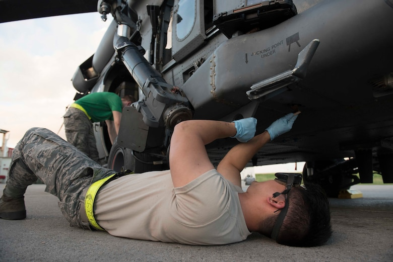 A maintainer from the 33d Helicopter Maintenance Unit, cleans an HH-60G Pave Hawk while checking for corrosion Oct. 25, 2016, at Kadena Air Base, Japan. The 33rd HMU supports the helicopters used by the 33rd Rescue Squadron maintainers to perform their operations.  (U.S. Air Force photo by Senior Airman Omari Bernard/Released)