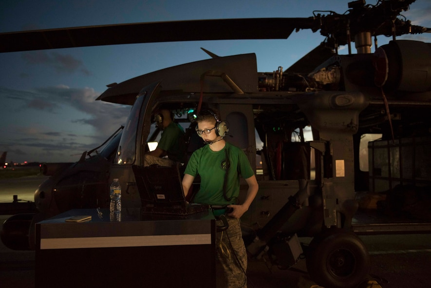 U.S. Air Force Airman 1st Class Jessica Games, 33rd Helicopter Maintenance Unit flight control systems technician, checks technical orders while performing maintenance on an HH-60G Pave Hawk Oct. 25, 2016, at Kadena Air Base, Japan. The 33rd HMU technicians work around the clock to ensure the helicopters are deployable at a moment's notice. (U.S. Air Force photo by Senior Airman Omari Bernard/Released)