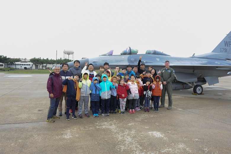 Children from Sinsido elementary school stand in front of an F-16 Fighting Falcon at Kunsan Air Base, Republic of Korea, Oct.28, 2016. The children participated in a base tour that included a trick-or-treat Halloween event. (U.S. Air Force photo by Senior Airman Michael Hunsaker/Released)