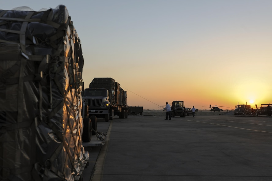 Contractors assigned to the 39th Logistics Readiness Squadron strap down cargo Oct. 19, 2016, at Incirlik Air Base, Turkey. The equipment will be used by members of the 447th Air Expeditionary Group to conduct missions in support of Operation INHERENT RESOLVE. (U.S. Air Force photo by Airman 1st Class Devin M. Rumbaugh)