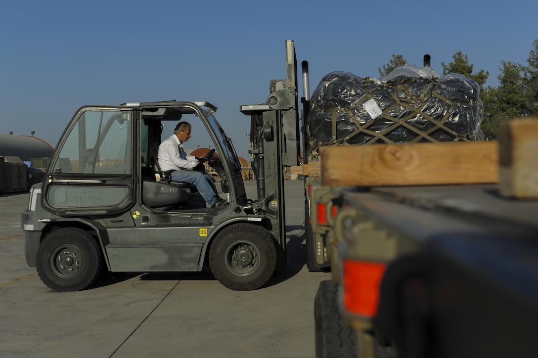 Contractors assigned to the 39th Logistics Readiness Squadron load a pallet onto a semi-truck Oct. 19, 2016, at Incirlik Air Base, Turkey. The 39th LRS aids Operation INHERENT RESOLVE by moving cargo via ground, fueling, and vehicle operations. (U.S. Air Force photo by Airman 1st Class Devin M. Rumbaugh)