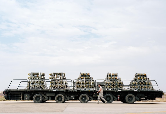 An Airman with the 332nd Expeditionary Logistics Readiness Squadron inspects pallets of unloaded cargo in support of Combined Joint Task Force - Operation Inherent Resolve, Oct. 28, 2016. The 332nd ELRS plans, supplies and distributes worldwide expeditionary combat support throughout the U.S. Air Forces Central Command area of operations. (U.S. Air Force photo by Senior Airman Jordan Castelan)