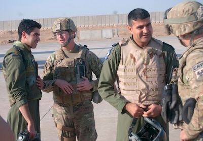 U.S. Air Force Lt. Col. Blaine Baker, left, director of tactical operations center operations, 821st Crisis Response Group, speaks with a pilot of an Iraqi air force C-130J Super Hercules after their landing at Qayyarah West Airfield, Iraq, Oct. 30, 2016. This was the first time a fixed wing aircraft from the Iraqi security forces landed at Qayyarah West Airfield since the base was occupied by Islamic State of Iraq and the Levant in 2014. Coalition forces reconstructed the airfield as part of their effort to assist the Iraqi security forces as the seize territory from ISIL. The Qayyarah West Airfield serves as a logistics hub for ongoing operations in northern Iraq. (U.S. Army photo by 1st Lt. Daniel Johnson)