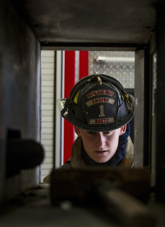 Staff Sgt. Crystal Baetz, a U.S. Army Reserve military police Soldier with the 603rd Military Police Company in Belton, Missouri, prepares her gear before beginning a firefighter training simulation at the Highland Park Fire Department in Highland Park, Michigan, Oct. 13. The exercise is designed to train firefighters to find other firefighters who have become immobile and carry them to safety. During the training, Baetz had to wear her usual 80-pound load of gear, carry a full sized fire hose, wear a gas mask and find her partner while wearing a blindfold in order to simulate a building densely filled with smoke and carbon dioxide. Baetz is the first female interior firefighter at that location. She is also a 911 dispatcher and a combatives level four qualified instructor. (U.S. Army Reserve photo by Sgt. Stephanie Ramirez)