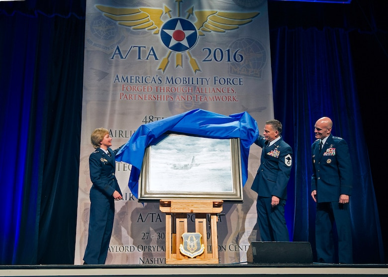"Lt. Gen. Maryanne Miller, chief of the Air Force Reserve, Senior Master Sgt. Darby Perrin, and Gen. Carlton D. Everhart III, Air Mobility Command commander, unveil the painting ""Deepwater Horizon"" at the 48th annual Air Mobility Command and Airlift/Tanker Association Symposium in Nashville, Tennessee. The painting, created by Perrin, is the newest addition to the Air Force Art Program depicts two C-130H Hercules Modular Aerial Spray Systems and Citizen Airmen from the 910th Airlift Wing, Youngstown Air Reserve Station, Ohio, in the cleanup effort following the 2010 BP Deepwater Horizon oil spill. The painting will join nearly 9,000 other works in the Air Force Art Program. These works document the history of Air Force Airmen, equipment, locations and activities. While the 910th AW's aerial sprays are commonly known for insect and vegetation control, the wing has assisted the U.S. Coast Guard with oil spill cleanup for almost 20 years. The cleanup mission lasted five weeks and AF Reserve aircrews sprayed approximately 30,000 acres with oil dispersant during the cleanup effort. (U.S. Air Force photo by Matthew A. Ebarb)"