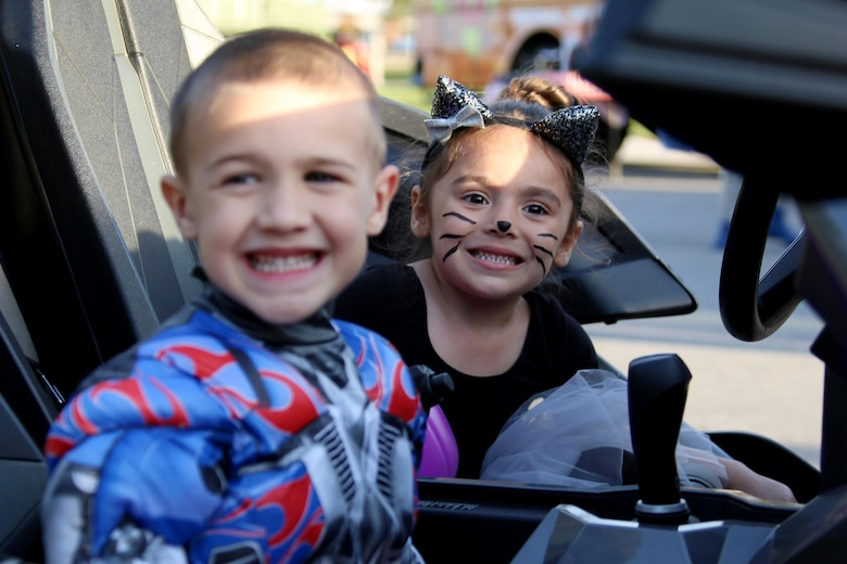Cayden, 4, left, and Audrey, 4, smile for a photo during a Trunk or Treat event aboard Marine Corps Air Station Cherry Point, N.C., Oct. 27, 2016. Marine Corps Community Services hosted the Halloween-inspired event that included face painting; touch the truck displays; and a family glow dance party. Decorated trunks were judged and the highest-rated contestants received door prizes. (U.S. Marine Corps photo by Cpl. Jason Jimenez/Released)