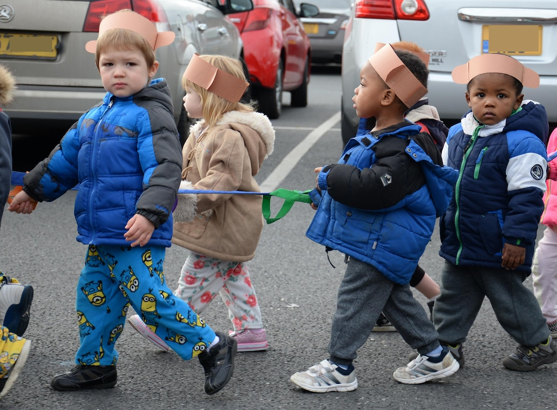 Team Mildenhall children take part in a parade during a Fall Festival Oct. 28, 2016, at the child development center on RAF Mildenhall, England. Children of various ages took part in the parade and games. (U.S. Air Force photo by Gina Randall)