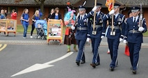 Airmen from the Team Mildenhall Honor Guard join children to take part in a parade during a Fall Festival Oct. 28, 2016, at the child development center on RAF Mildenhall, England. Children of all ages took part in a parade, games and a pumpkin patch. (U.S. Air Force photo by Gina Randall)