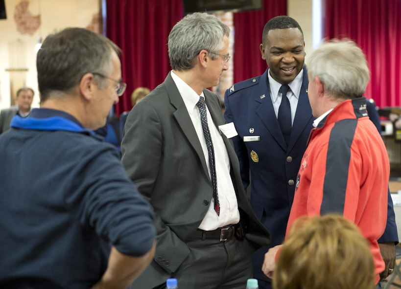 Col. Alfred K. Flowers, Jr., 52nd Medical Group commander, Spangdahlem Air Base, Germany, greets a group of German doctors on base at the Brick House Oct. 27 during the 52nd MDG's first executive-level Eifel Health Consortium. Spangdahlem Airmen and their families rely on local doctors for specialty healthcare. The event brought more than 20 German doctors to the base, which allowed them and base medical care providers to discuss respective healthcare capabilities, practices, philosophies, approaches and concerns in an effort to continuously provide trusted care to Spangdahlem families.