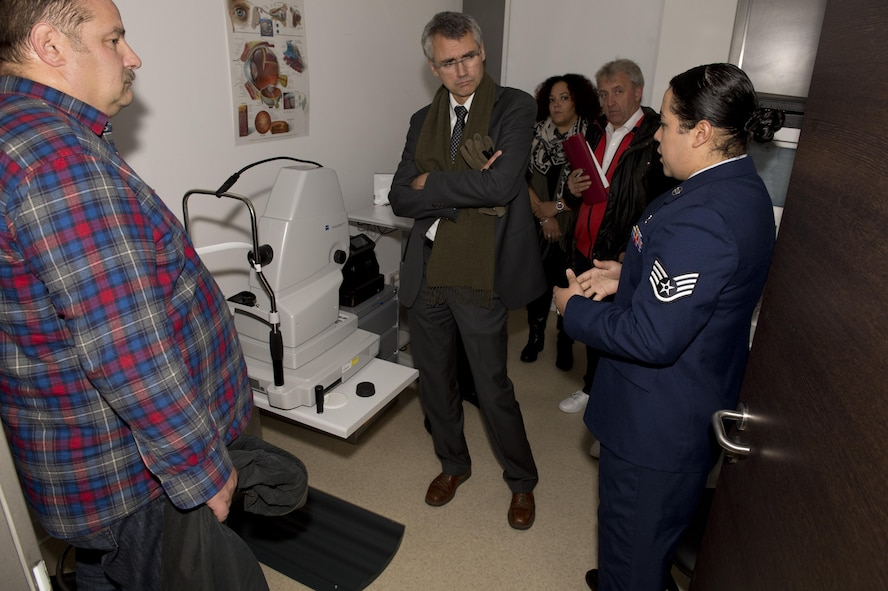 Staff Sgt. Ivonn Denton, an optometry clinic technician at the medical treatment facility at Spangdahlem Air Base, Germany, tells a group of German doctors about the optometry clinic's optical coherence tomography machine, which measures optic nerve function, during the Spangdahlem MTF's Eifel Health Consortium Oct. 27. More than 20 German doctors from four major, local hospitals in Bitburg, Trier, and Wittlich, Germany attended the event.