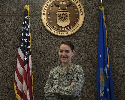 Staff Sgt. Jessica Thomas, 90th Missile Wing legal NCO in charge of military justice, poses inside the court room  at F.E. Warren Air Force Base, Wyo., Oct. 27, 2016. Thomas is known for keeping a positive attitude and working with a smile on her face. (U.S. Air Force photo by Senior Airman Brandon Valle)