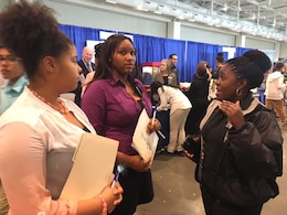 "(Right) Stephanie Coleman, an Equal Opportunity Employment specialist from the U. S. Army Corps of Engineers Nashville District talks with students for future STEM careers during the ""My Future, My Way"" Career Exploration Fair at the Metro Nashville Public schools Academies of Nashville and the Nashville Area Chamber of Commerce at Music City Convention Center Oct. 27, 2016."