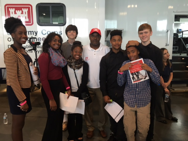 """James Sowell, safety officer with the Nashville District Operations Division from the U. S. Army Corps of Engineers Nashville District poses with with students from Hillwood High School during the """"My Future, My Way"""" Career Exploration Fair at Music City Convention Center Oct. 27, 2016."""