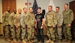 MACDILL AFB, Fla. (October 25, 2016) – U.S. Army Maj. Gen. Edward F. Dorman III, director for logistics, J-4, U.S. Central Command (center left) and his team of CENTCOM engineers welcomed U.S. Army Sgt. Corey M. Robinson (center right) to the headquarters and made him an honorary CENTCOM engineer. Robinson, an ROTC cadet at Tennessee Tech University and a member of the Tennessee National Guard, was involved in a near-fatal motor vehicle accident while transiting to Camp Shelby, Mississippi. He is currently recovering and is dedicating to becoming an Army engineer officer. (U.S. Central Command photo by Marine Sgt. Jordan Belser/ Released)