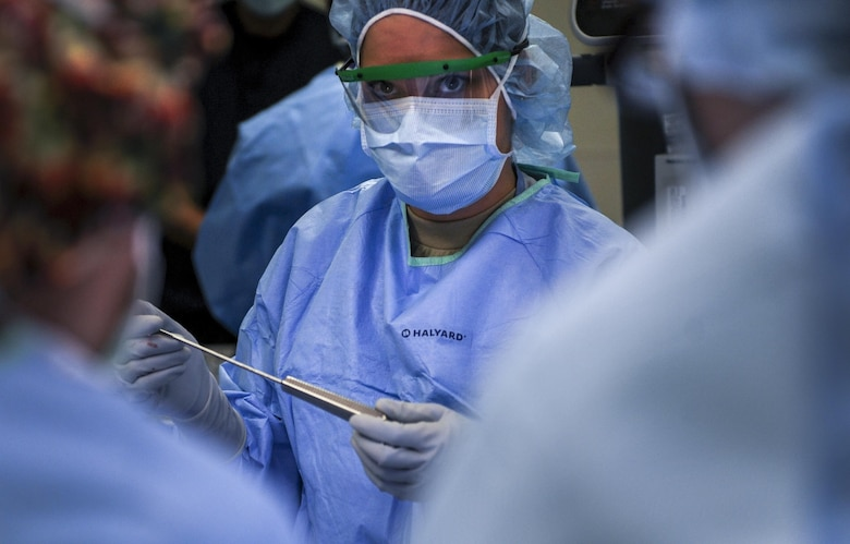 An Airman prepares to hand a surgical instrument to the surgeon during an ACL surgery at the Mike O'Callaghan Federal Medical Center at Nellis Air Force Base, Nev., Oct. 17, 2016. The orthopedics unit of the 99th Surgical Operations Squadron performs a variety of surgeries in order to help Airmen return to top-form after being injured. (U.S. Air Force photo by Airman 1st Class Kevin Tanenbaum/Released)