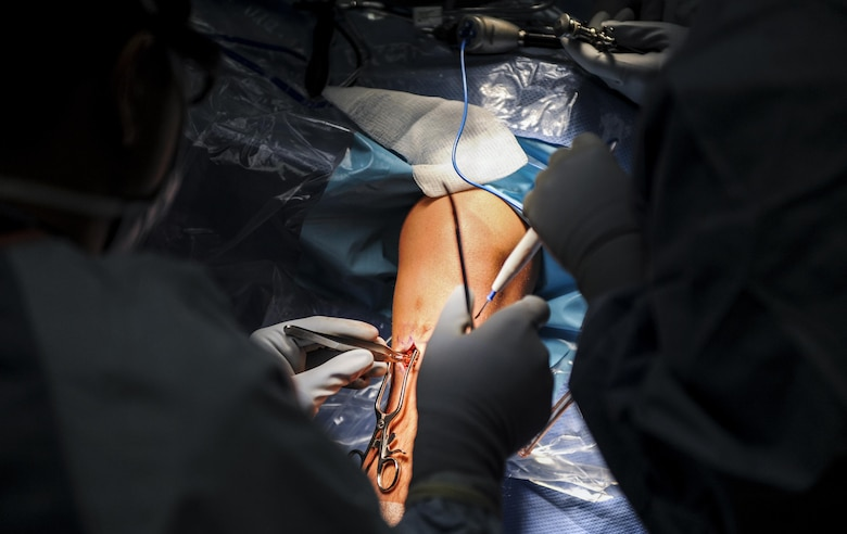 Maj. Ryan Swope, 99th Surgical Operations Squadron orthopedic surgeon, makes an incision during a surgery to repair an Airman's ACL at the Mike O'Callaghan Federal Medical Center on Nellis Air Force Base, Nev., Oct. 17, 2016. The 99th Surgical Operations Squadron goal is to get Airmen back to their mission by providing surgical services in any manner that they need in. (U.S. Air Force photo by Airman 1st Class Kevin Tanenbaum/Released)