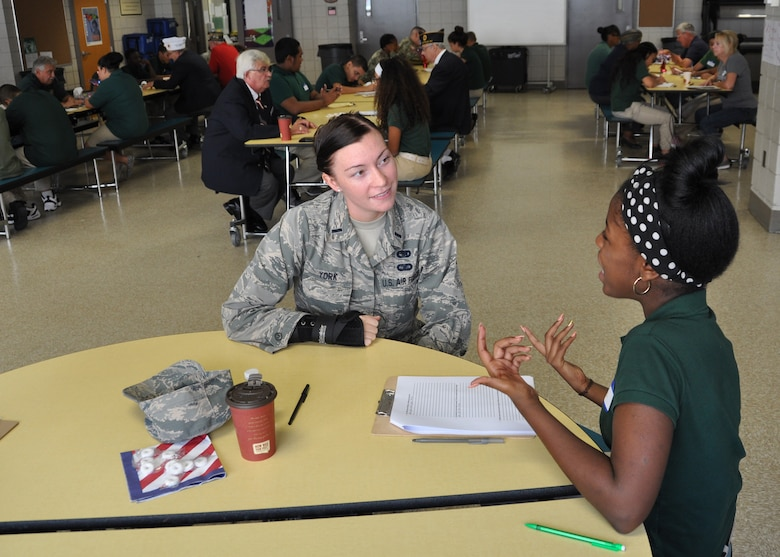 1st Lt. Marie York, 914th Logistics Readiness Squadron, is interviewed by an eighth grade student from the Bilingual Center School 33 in Buffalo, N.Y., October 5, 2016.  Several members of the 914th and 107th Airlift Wings, along with other Western New York veterans participated in a veterans' interview day.  Students from School 33 conducted one on one interviews with local veterans as the eighth graders complete an advanced school project to develop a deeper understanding of the United States Armed Services.  (U.S. Air Force photo by Master Sgt. Kevin Nichols)