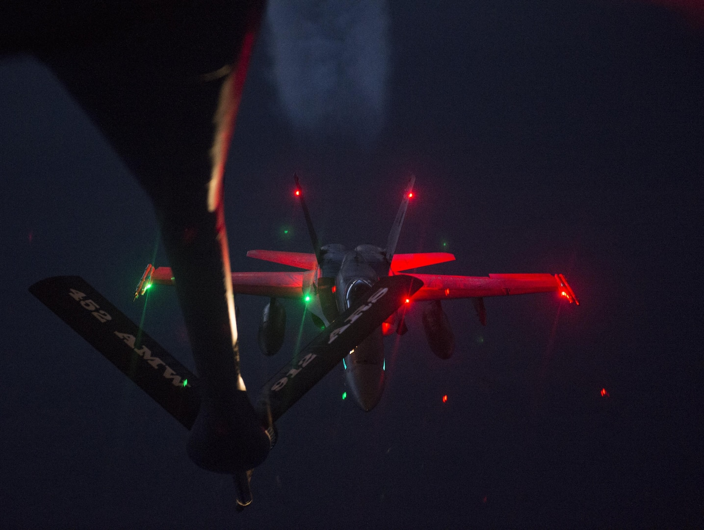 A U.S. Air Force KC-135 Stratotanker flown by the 912th Air Refueling Squadron from March Air Force Base, Calif., provides refueling capabilities to Royal Canadian Air Force CF-18s while both units participate in the Vigilant Shield 2017 Field Training Exercise 20 Oct., 2016, in the high arctic.  VS17 is an annual exercise sponsored by The North American Aerospace Defense Command and led by Alaskan NORAD Region, in conjunction with Canadian NORAD Region and Continental NORAD Region, who undertake field training exercises aimed at improving operational capability in a bi-national environment.  This year's exercise sees NORAD building on previous years' training successes when deploying air assets and personnel to the far north to exercise sovereignty operations in North America's northern aerospace and in the high Arctic. This exercise provides crucial training opportunities for numerous military personnel with a variety of aircraft and assets from Canada and the United States to improve interoperability and to demonstrate NORAD's ability to defend North America. (U.S. Air Force Photo by Tech. Sgt. Gregory Brook)