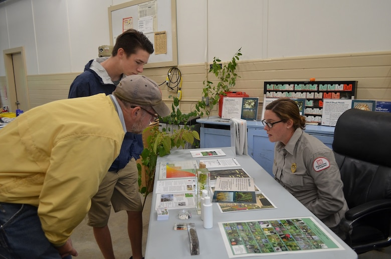 Park Ranger Alicia Lacrosse explains the displays on the table during Surry's 75th anniversary commemoration, October 1, 2016.