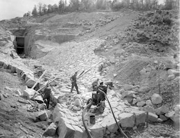 Contractors perform work constructing the Surry Mountain Dam in Surry, New Hamphsire in this October 1941 photo.