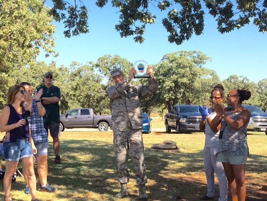 "Air Force Col. Ken Ruthardt, Defense Logistics Agency Aviation commander at Oklahoma City, holds up the ""DLA Aviation vs. DLA Distribution Food Fight Challenge"" trophy in victory Sept. 22, 2016, during a DLA employee appreciation picnic for DLA Employees on Tinker Air Force Base.  The two organizations challenged each other to raise the most food to support the Feds Feed Families program and raised 2,456 pounds of food, which was donated to the Regional Food Bank of Oklahoma.  The organizations plan on making the ""Food Fight Challenge"" an annual event to support their community."
