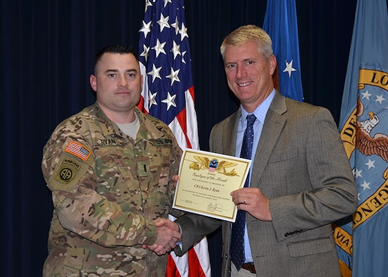Defense Logistics Agency Aviation's August 2016 Employee of the Month is Chief Warrant Officer 4 Kevin Ryan, a readiness officer for the Customer Operations Directorate in Richmond, Virginia. DLA Aviation's Chief of Staff Steve Kinskie presents Ryan with the certificate during a ceremony held Oct. 27, 2016 on Defense Supply Center Richmond.