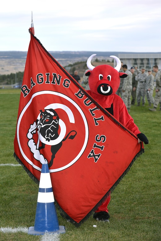 "Cadet Squadron 06 mascot, the ""Raging Bull,"" shows off the squadron's flag at the Commandant's Challenge, Oct. 28, 2016, at the Air Force Academy. The challenge is a physically and mentally demanding 48-hour training exercise and contest between the Cadet Wing's 40 cadet squadrons. Cadet Squadron 06 beat out the competition to take home the Commandant's Challenge trophy. (U.S. Air Force photo/Jason Gutierrez)"