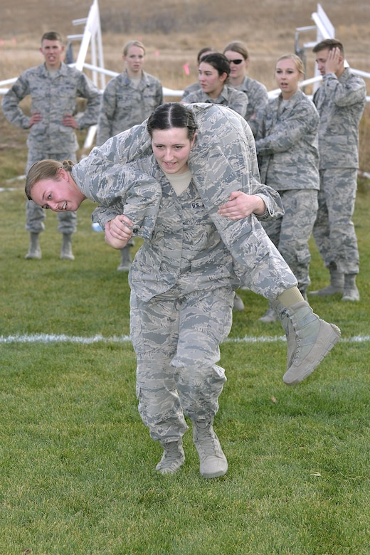 A cadet carries another cadet during one of several relays in the Combat Fitness Challenge portion of the Commandant's Challenge, Oct. 28, 2016, at the U.S. Air Force Academy. The Commandant's Challenge is a physically and mentally demanding 48-hour training exercise and contest between the Cadet Wing's 40 cadet squadrons. (U.S. Air Force photo/Jason Gutierrez)