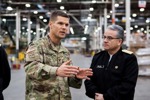 Army Col. Brad Eungard, commander of DLA Distribution Susquehanna, Pa., gives Rear Adm. Guido Cabrera and other members of the Chilean Navy a tour through the Eastern Distribution Center at DLA Distribution Susquehanna, Pa., on October 28.