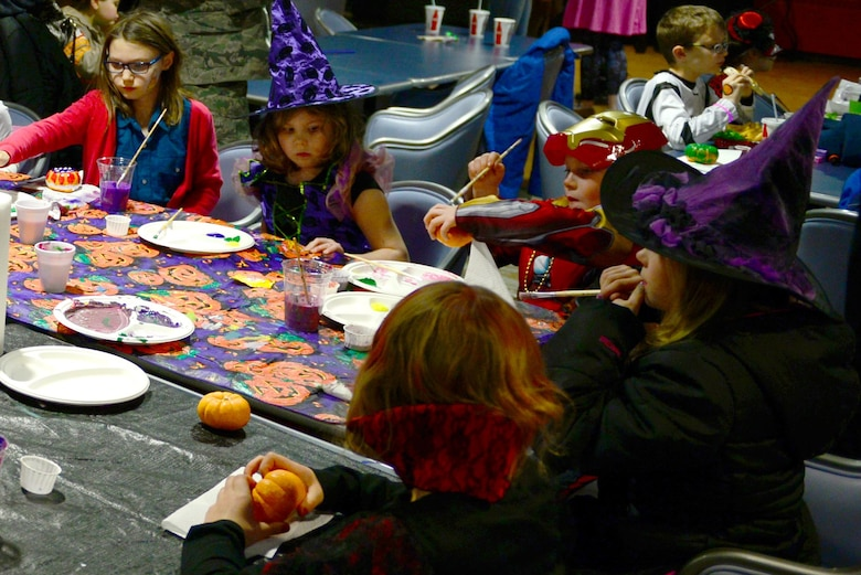 Children paint pumpkins during the 2016 Fall Festival at the Yukon Club, Oct. 28, 2016, at Eielson Air Force Base, Alaska. Pumpkin painting was one of the most popular activities during the festival and allowed children to show their artistic talents. (U.S. Air Force photo by Airman Eric M. Fisher)