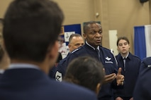 Gen. Darren W. McDew, U.S. Transportation Command commander, speaks with Junior Air Force Reserve Officer Training Corps cadets during the 48th Airlift/Tanker Association Symposium in Nashville, Tenn., Oct. 27, 2016. The symposium served as a key professional development forum for mobility Air Forces Airmen by enabling direct access to senior mobility leaders and fostering an environment encouraging open dialogue and honest discussions. (U.S. Air Force photo by Senior Airman Megan Friedl)