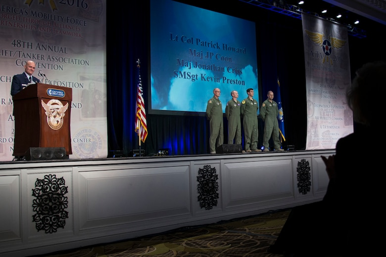 Gen. Carlton D. Everhart II, the Air Mobility Command commander, recognizes four individuals from an aeromedical evacuation team during the 48th Air Mobility Command and Airlift/Tanker Association Symposium in Nashville, Tennessee, Oct. 29, 2016. In 2010, the team transported a U.S. Marine Sergeant from Afghanistan to the U.S. to receive medical care after he suffered injuries from an improvised explosive device while on patrol. (U.S. Air Force photo by Airman 1st Class Melissa Estevez)