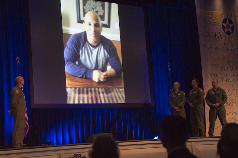 Retired Marine Sergeant Carlos Evans thanks the aeromedical evacuation team during the 48th Air Mobility Command and Airlift/Tanker Association Symposium in Nashville, Tennessee, Oct. 29, 2016. In 2010, the Airmen transported Evans from Afghanistan to the U.S. on a C-17 to receive medical care after he suffered injuries from an improvised explosive device while on patrol. Evans was unconscious from the time he stepped on the IED in Afghanistan until he woke up at Walter Reed Medical Center in Bethesda, Maryland. During his keynote address, Everhart provided Evans his first opportunity to put faces and names to the aeromedical evacuation team who helped him. (U.S. Air Force photo by Airman 1st Class Melissa Estevez)