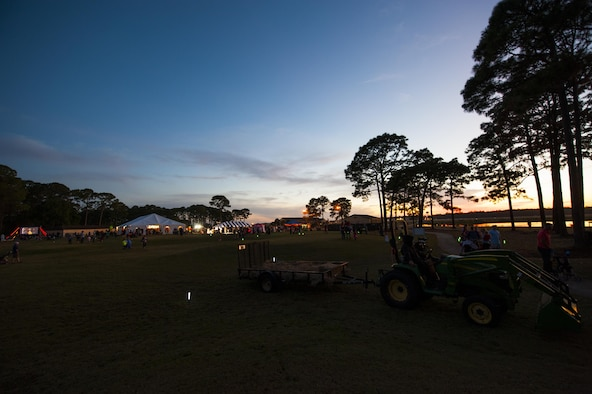 The sun sets during the Haunted Lakes Fall Festival at Gator Lakes Golf Course on Hurlburt Field, Fla., Oct. 28, 2016.  The festival was a free event hosted by the 1st Special Operations Force Support Squadron with complimentary food and fun for kids of all ages that included haunted hay rides, costume contests, games and a movie. (U.S. Air Force photo by Airman 1st Class Joseph Pick)