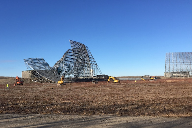 CLEAR AIR FORCE STATION, Alaska – Crews use cables and excavators to demolish the defunct Ballistic Missile Early Warning System radar at Clear Air Force Station, Alaska, Oct. 18, 2016. The radar was taken down and is being removed and recycled to make way for new construction. (Courtesy photo)