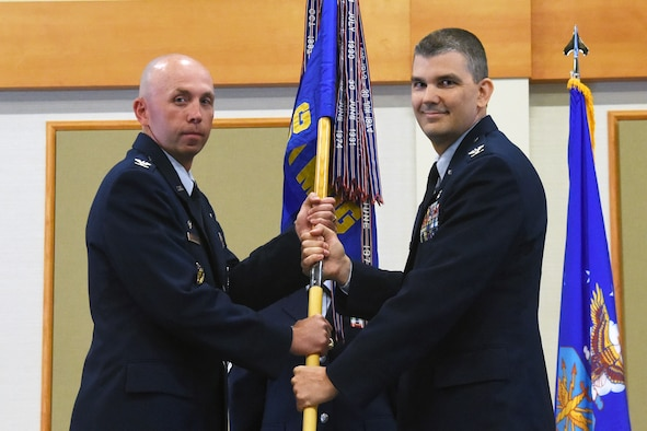 Col. Craig Forcum, right, accepts command of the 341st Medical Group from Col. Ron Allen, 341st Missile Wing commander, during a change of command ceremony at the Grizzly Bend July 7, 2016, at Malmstrom Air Force Base, Mont. Forcum arrived at Malmstrom on June 30, and took command of the 341 MDG on July 7, 2016. (U.S. Air Force photo/Senior Airman Jaeda Tookes)