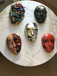 Masks, decorated by service members, sit on display as part of the Creative Forces: NEA Military Healing Arts Network at the National Intrepid Center of Excellence in Bethesda, Md.,  Oct. 21, 2016. National Endowment for the Arts courtesy photo