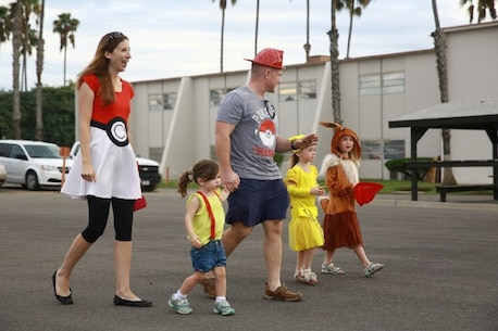 """Marines and their families participate in """"Trunk or Treat"""" at Marine Corps Base Camp Pendleton, Calif., Oct. 28, 2016. The event was hosted by I Marine Expeditionary Force Headquarters Group, and included trick or treating, games, a costume contest, and a free movie showing. (U.S. Marine Corps photo by Pfc. Robert Bliss)"""