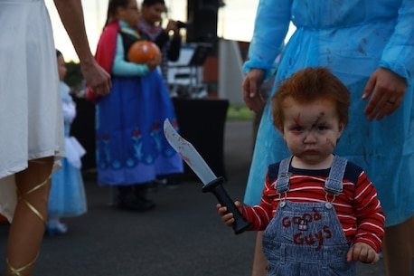 """Families participate in """"Trunk or Treat"""" at Marine Corps Base Camp Pendleton, Calif., Oct. 28, 2016. The event was hosted by I Marine Expeditionary Force Headquarters Group, and included trick or treating, games, a costume contest, and a free movie showing. (U.S. Marine Corps photo by Pfc. Robert Bliss)"""