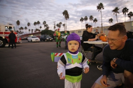 """Master Sgt. Scott Dunn, public affairs chief, I Marine Expeditionary Force and his son help celebrate """"Trunk or Treat,"""" at Marine Corps Base Camp Pendleton, Calif., Oct. 28, 2016. The event was hosted by I Marine Expeditionary Force Headquarters Group, and included trick or treating, games, a costume contest, and a free movie showing. (U.S. Marine Corps photo by Pfc. Robert Bliss)"""